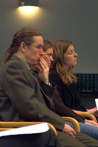 Emily Fisher, Michele Black and teammate Eric Johnson sit through this year's hearing for SB 5838. None of the three were called to testify. Photo credit: Eden Palmer