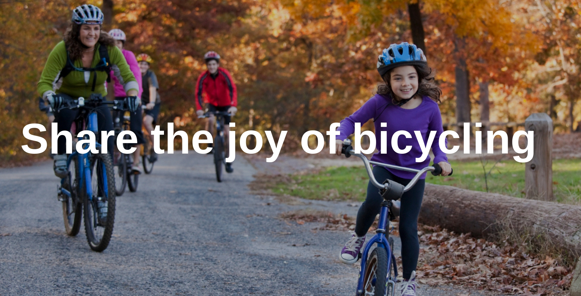 family riding bicycles in fall