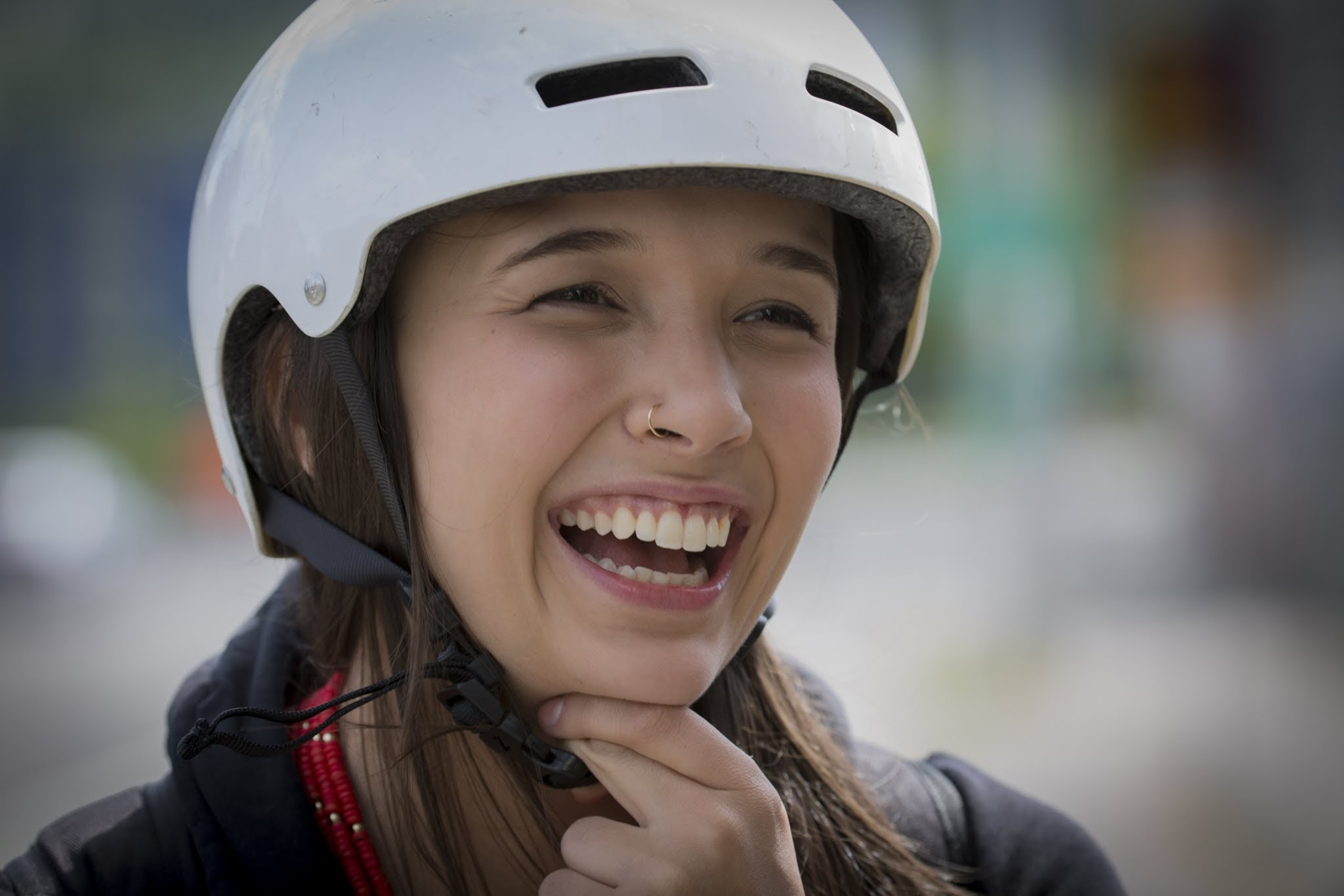 Woman smiling with white helmet