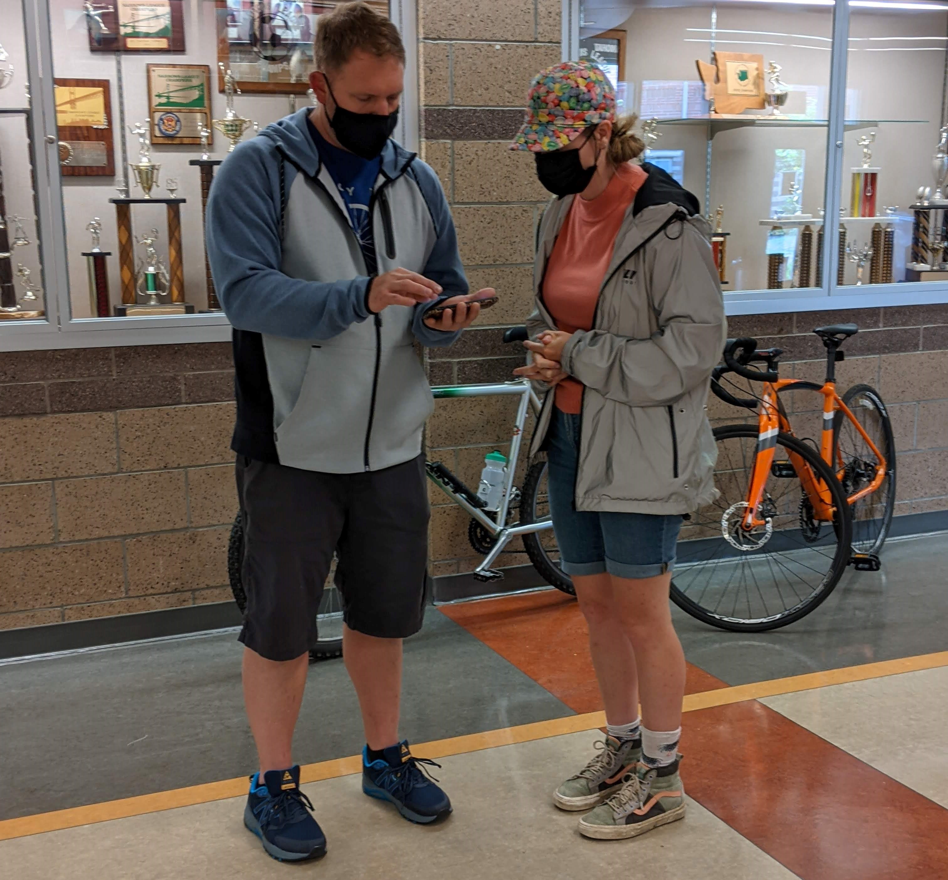 Mt. Tahoma high school teacher and Major Taylor Project volunteer Phil Lord does some route planning with MTP Ride Leader Sarah Conrad