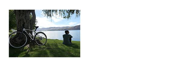 A Lake Chelan Tour Lite participant rests by the lake