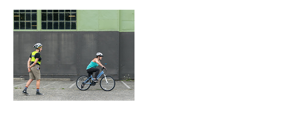 Amy teaching an adult student bicycle riding lessons