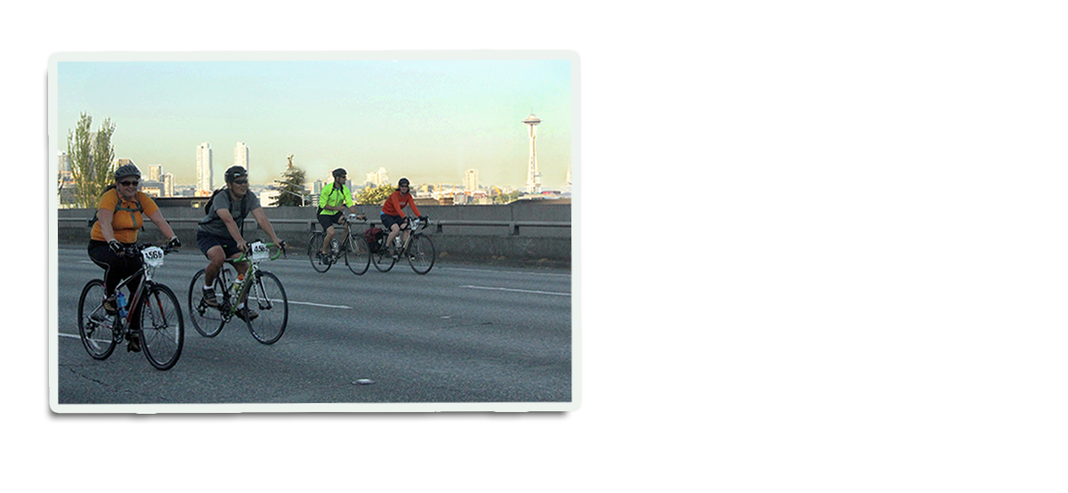 Bike riders ride on freeway without any cars