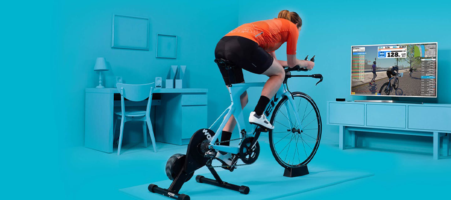 A graphic of a woman riding indoors in front of her TV
