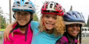 Three girls with their new bike helmets