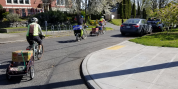 Cascade staff and volunteers deliver groceries by bike while staying 6 feet apart