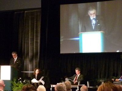 U.S. Transportation Secretary Ray LaHood at the podium, with HUD Secretary Shaun Donovan sitting.